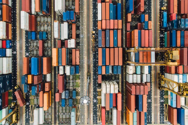 Bird's eye view of the containers waiting in Singapore's port to be shipped around the globe. Image: chuttersnap on Unsplash